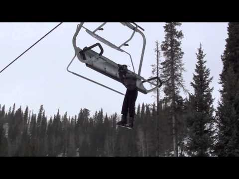 Boy hanging from ski lift