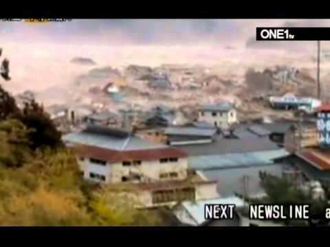 earthquake japan 2011 footage of tsunami waves hitting the coast of japan