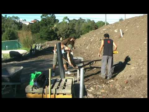 Tyres #1: Flat ground, tamping, water and getting hit in the head - CERES Earthships Australia