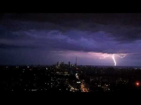 Intense thunder and lightning storm strikes CN Tower, Toronto, Canada.  August 24, 2011.