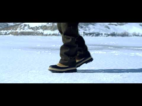 Royalty Free Stock Footage of Snow boots walking across the snowy ground.