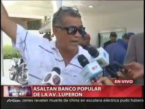 Un muerto en asalto Banco Popular de la avenida Luperón