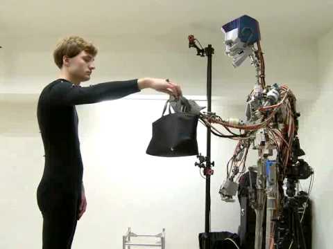 Synthesizing Object Receiving Motions of Humanoid Robots with Human Motion Database