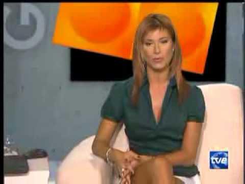 Sonia Ferrer   white short skirt and lovely crossed legs
