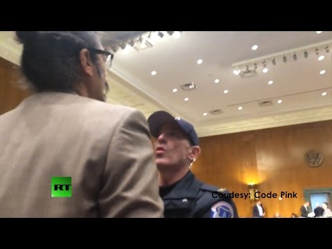 (brutality) arrest activist for asking questions of NSA's James Clapper
