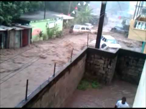 Cars washed away by heavy flooding in Dominica (TS Ophelia)