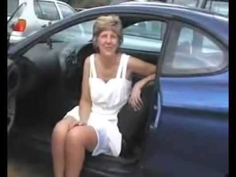 Mature upskirt in a car.