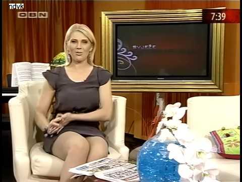 Marina Pelemis sexy crossed legs