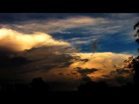 Colorful glitchy storm clouds sunset timelapse V10836