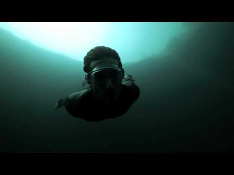 Guillaume Nery base jumping at Dean-s Blue Hole, filmed on breath hold by Julie Gautier