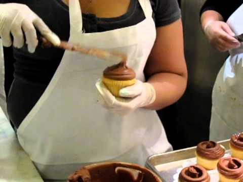 Magnolia Bakery - putting frosting on their cupcakes