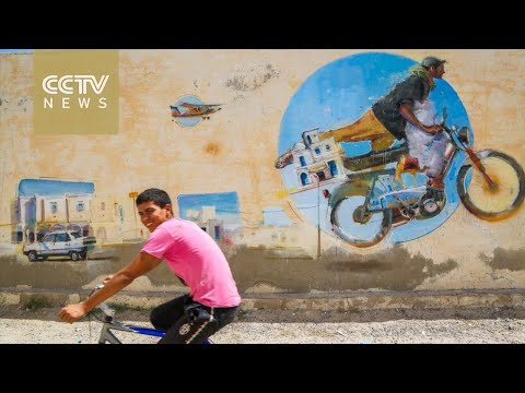 بالفيديو.... أمريكيون يلونون أطباق-دش- القاهرة بالوجوه الضاحكة