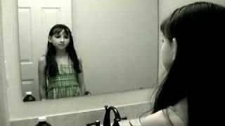 Cute Girl in Mirror