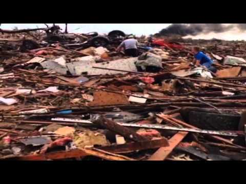 Raw: Walking in a Flattened Okla. Neighborhood