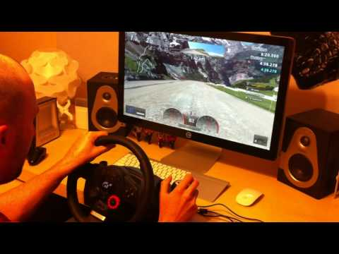 "Gran Turismo 5 Game Play on an Apple Cinema Display 27"" with Logitech Driving Force GT Wheel"
