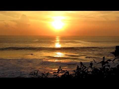 BEAUTIFUL Sunset at Pura Tanah Lot Sea Temple with Surfers - Bali Indonesia