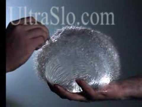 Busted water balloon in slow motion