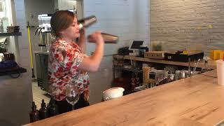Long Road Distillers bartender makes signature drinks