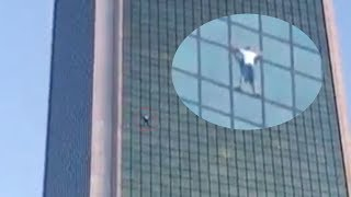 Polish climber scales Warsaw's 170 meter Marriott Hotel without ropes