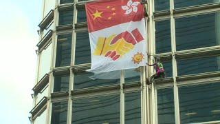 French 'Spiderman' scales HK skyscraper, unfurls 'peace' banner | AFP