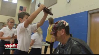 Students at Holy Spirit Elementary get rewarded for reading over summer break