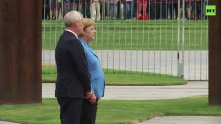 Merkel seen visibly shaking as she welcomes Finnish PM