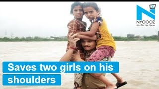 Gujarat Flood: Brave police rescue two children by carrying them on his shoulder