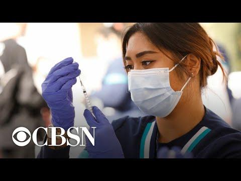 U.S. coronavirus vaccinations slow amid growing hesitancy