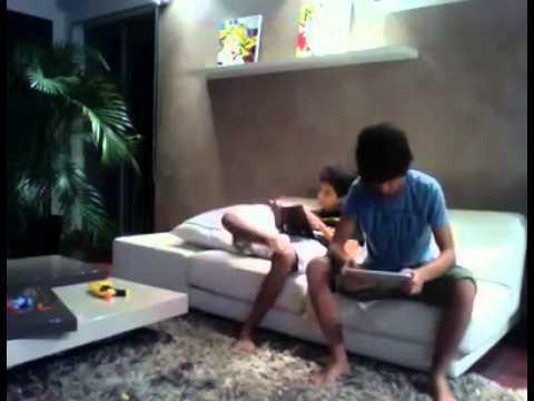 Boy slaps his brother with iPad
