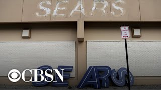 Sears retirees say life insurance benefits were dropped, and more MoneyWatch headlines
