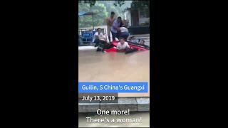 Rescuers save 5 people trapped in sinking SUV swept away by floodwaters