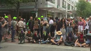 Relative calm returns in Portland following dueling protests