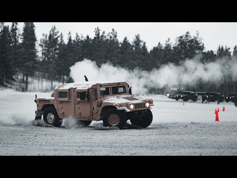 U.S. Marines in Norway learn how to drift armored vehicles on snow