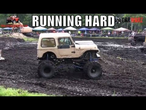 Tan Jeep Running Hard At Perkins Spring Mud Bog