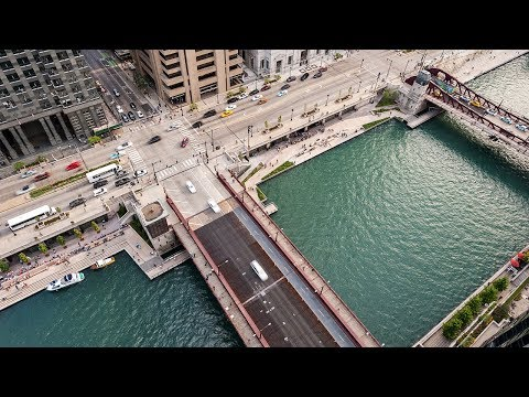 Drone footage tours bustling promenade on Chicago's riverfront