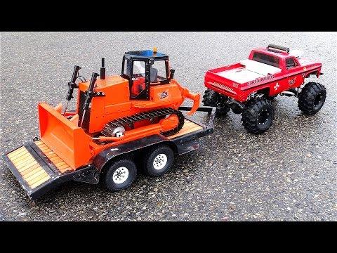 "RC ADVENTURES - ""BEAST"" Monster Truck pulls Mini Dozer on Trailer - Heavy Snow Removal - UCxcjVHL-2o3D6Q9esu05a1Q"