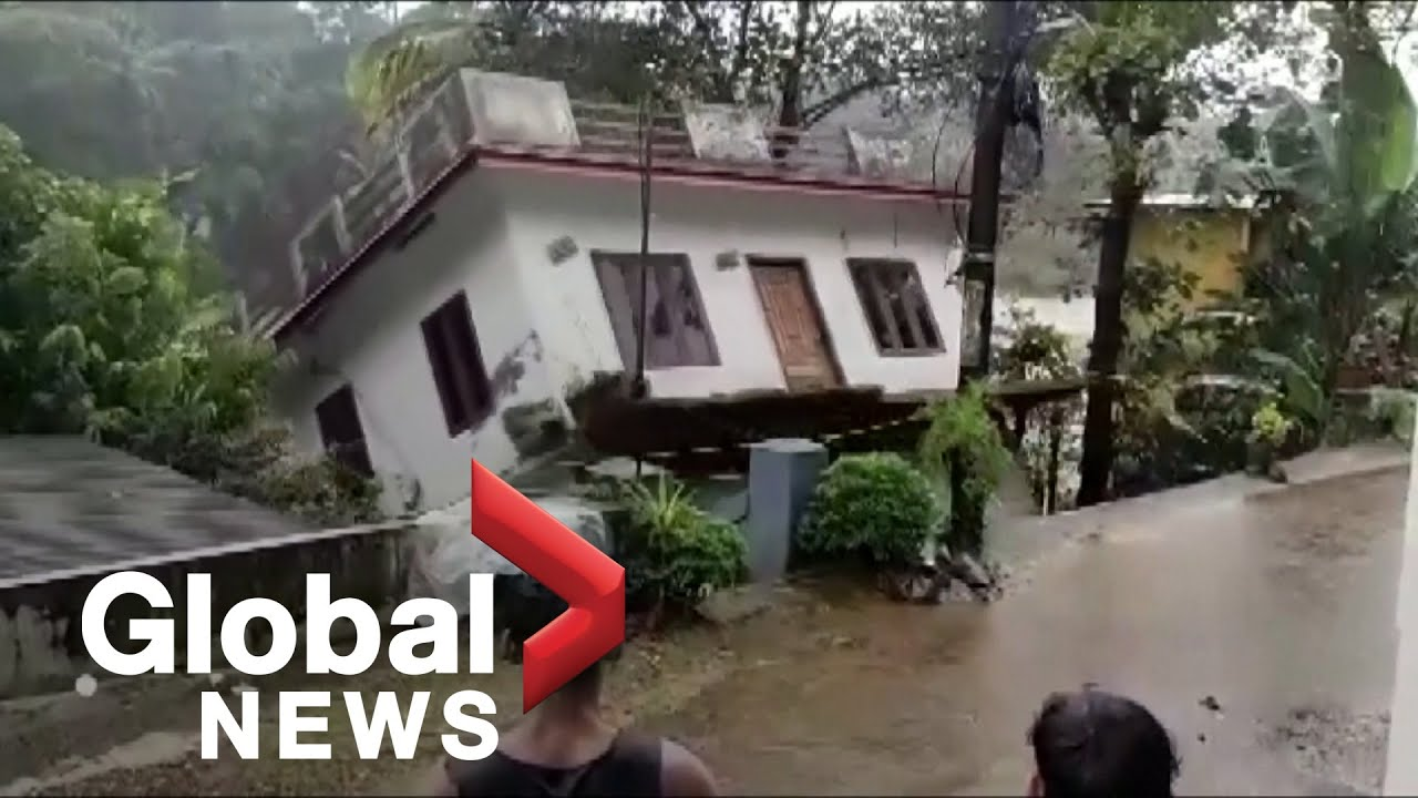Home in southern India collapses into river as flooding, landslides leave at least 21 dead