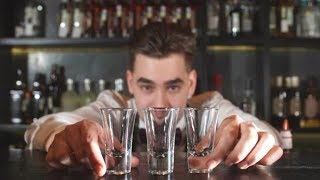 Smiling Happy Bartender Puts the Shot Glass for Vodka | Stock Footage - Videohive