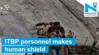 ITBP personnel protects Amarnath yatra pilgrims from stones