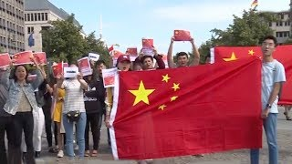 Overseas Chinese across Europe rally against violence