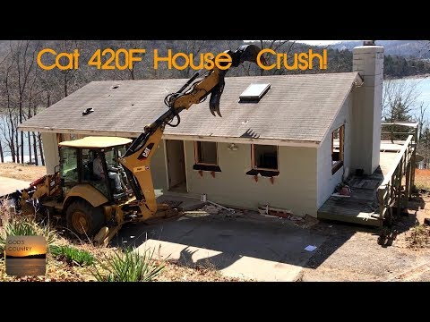 Tearing a house down with Cat 420F with PSM Tilt Coupler