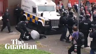 Belfast riot police clash with youths in stand-off over republican bonfire