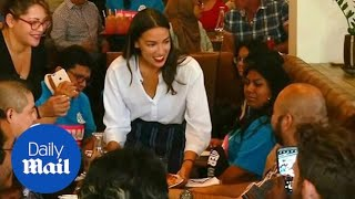 AOC back to bartender roots promoting wage increases for tip workers