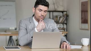 Pensive Businessman Working on Laptop | Stock Footage - Videohive