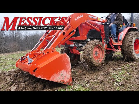 Stuck? Get your tractor out of the mud using your loader bucket. Picture