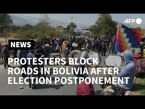 Bolivia: Protesters upset with election postponement block roads | AFP