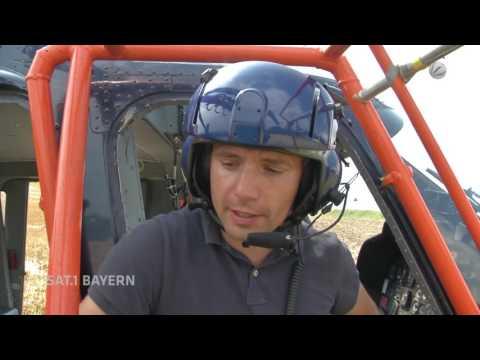 Sat. 1 Bayern: Montage von Vogelschutzfahnen per Helikopter