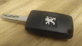 Sostituzione pila chiave Peugeot 207
