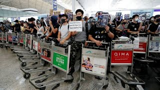 Hong Kong protesters stage new airport rally hours after flights resume