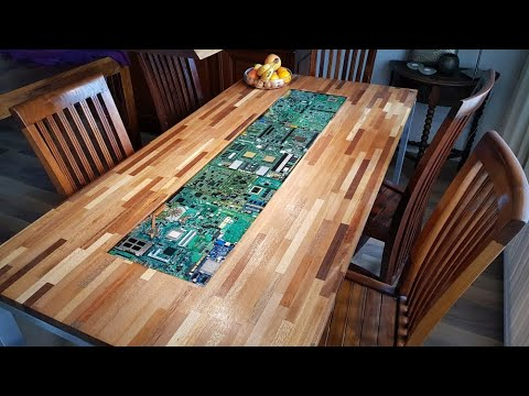 Circuit boards with lights in epoxy in a table - UCNdDV4vHKjuWOYlEW4HIk5w